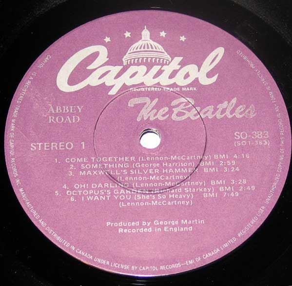"Close-up Photo of ""BEATLES Abbey Road Capitol Records"" Record Label"