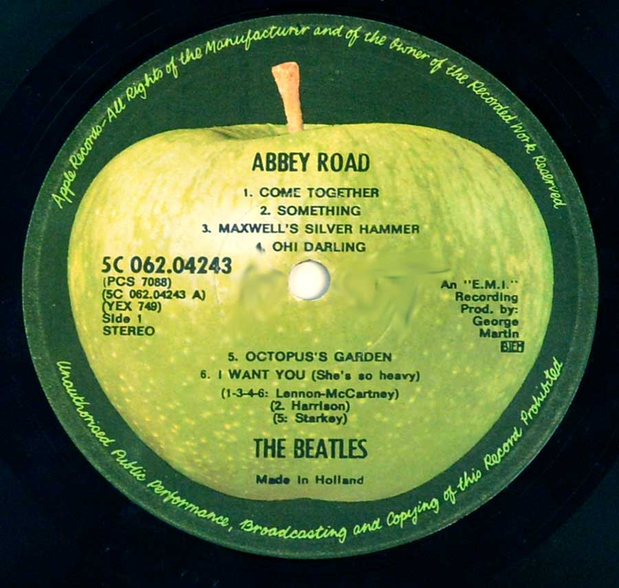 "Close up of record's label BEATLES - Abbey Road ( Genuine Netherlands release ) 12"" Vinyl LP Album Side One"