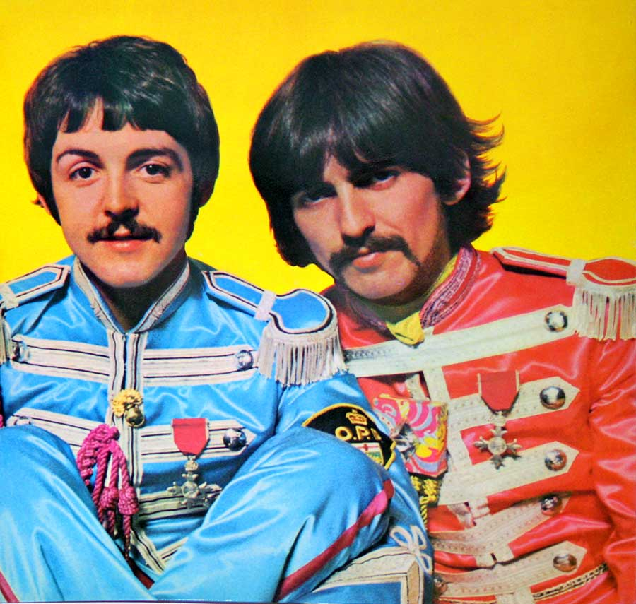 Photo of Paul McCartney and George Harrison on the inside cover page