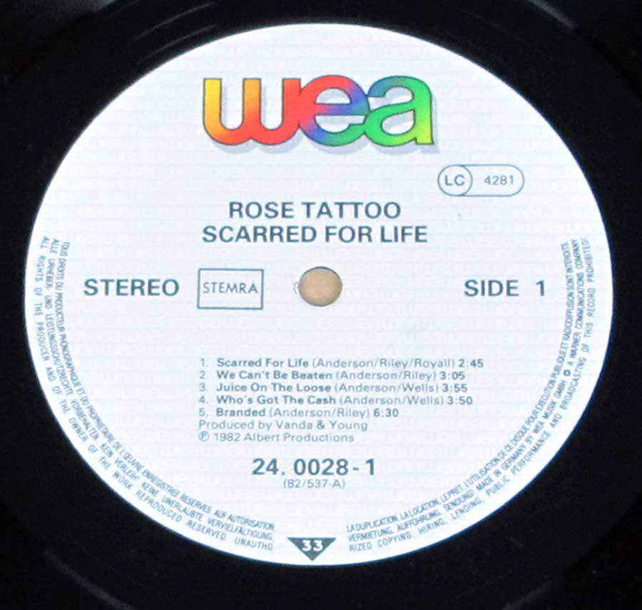 Close up of record's label ROSE TATTOO - Scarred for Life Side One
