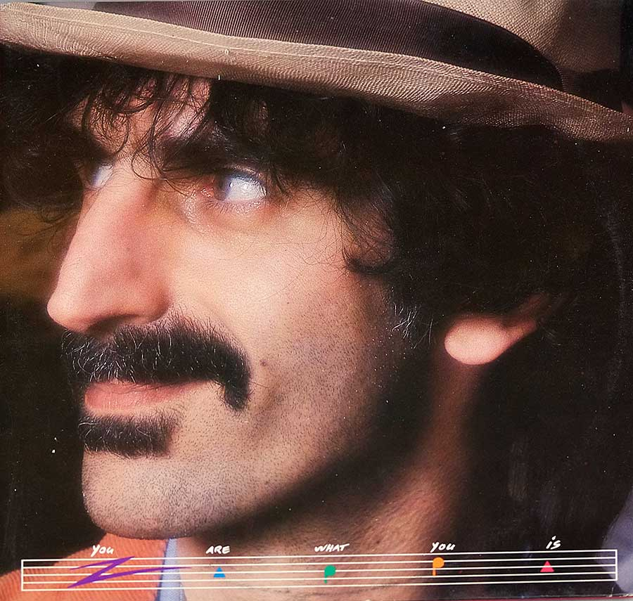 Large full page portrait photo of Frank Zappa on the front cover