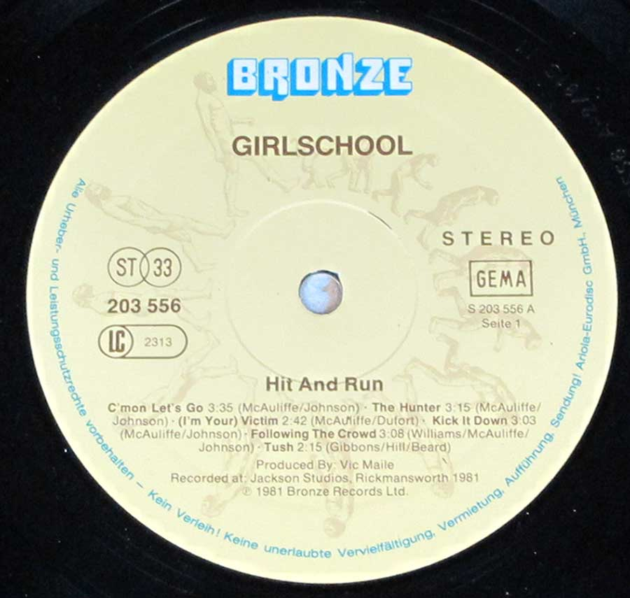 Close up of record's label GIRLSCHOOL - Hit and Run ( British Heavy Metal ) Side One