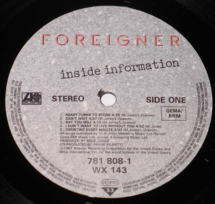 "Close up of record's label FOREIGNER - Inside Information 12"" Vinyl LP Album Side One"