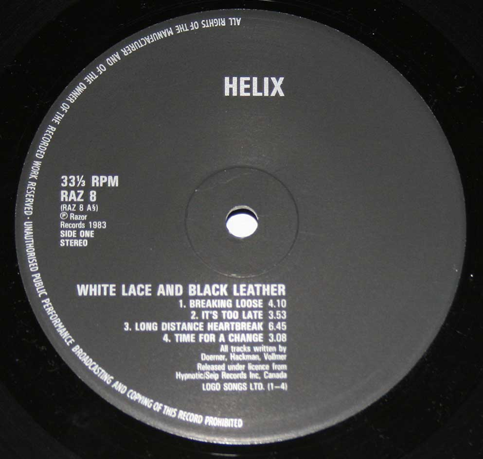 "Close-up Photo of the black ""Razor Records"" RAZ 8 Record label for ""HELIX - White Lace & Black Leather"""