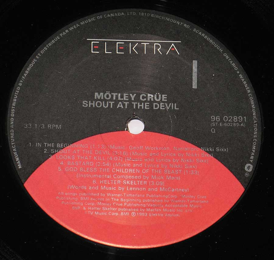 "Close up of record's label MÖTLEY CRÜE - Shout At The Devil Gatefold Cover 12"" Vinyl LP Album Side One"