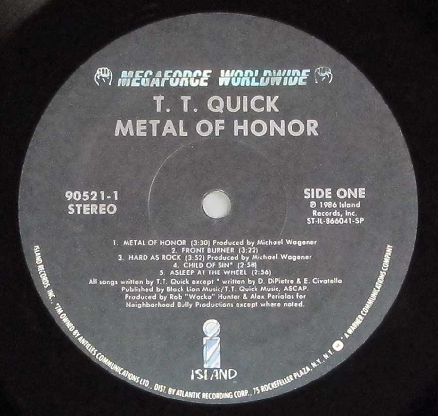 """Metal Of Honor"" Record Label Details: Black Colour Label Megaforce Worldwide 90521-1 , ST-IL-866031-SP ℗ 1986 Island Records, Inc Sound Copyright"