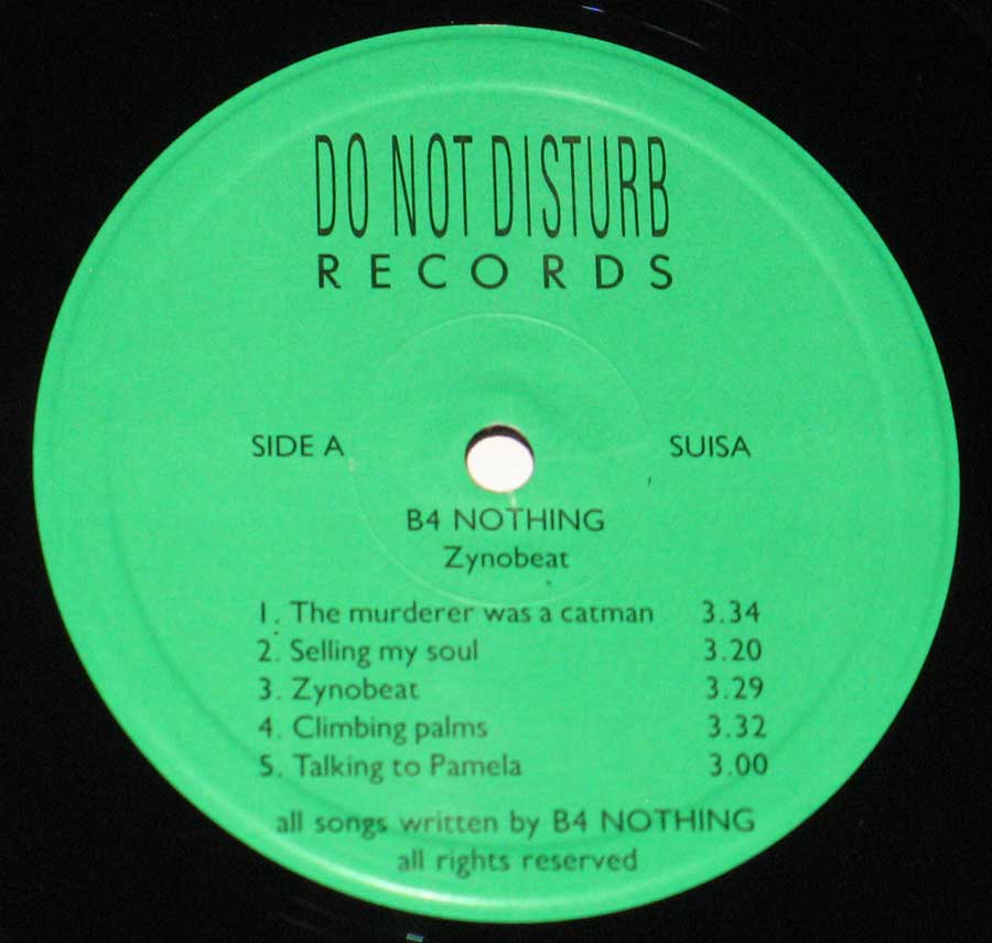 "Close-Up of the Green ""Do Not Disturb"" Records Label"