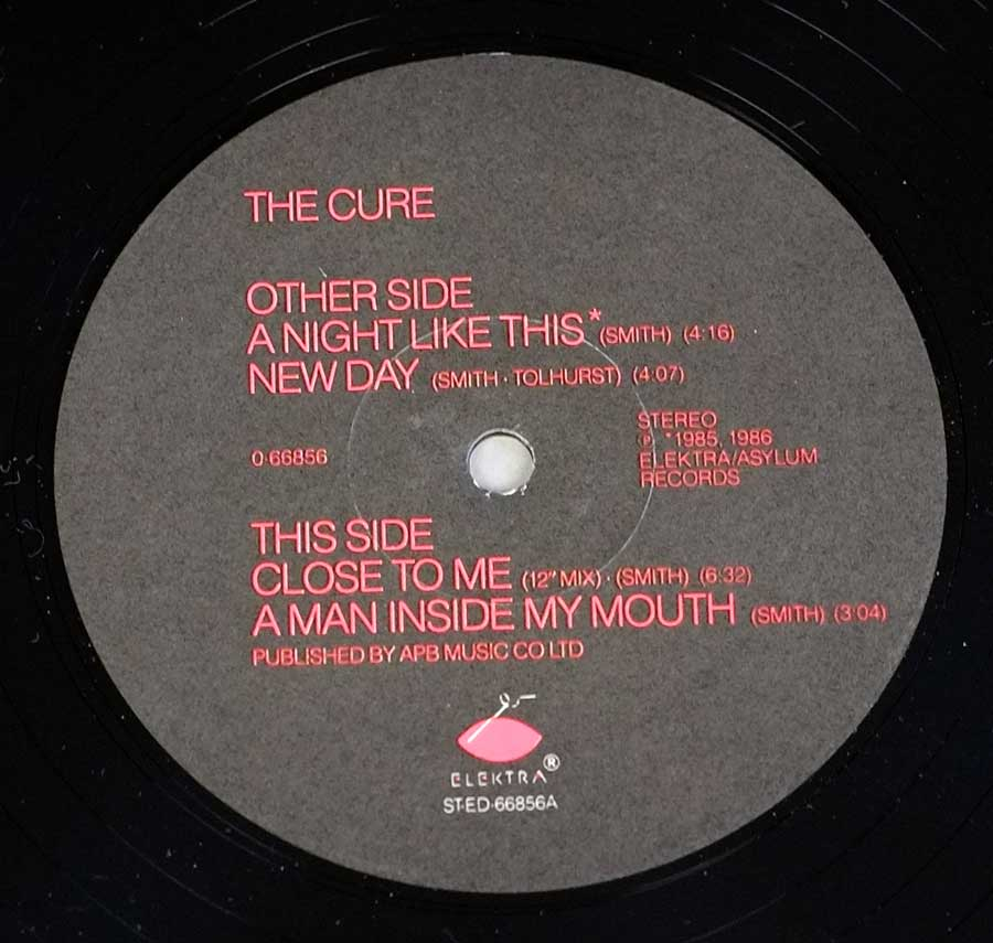 "Close up of record's label THE CURE - Quadpus 12"" LP Vinyl Album Side One"