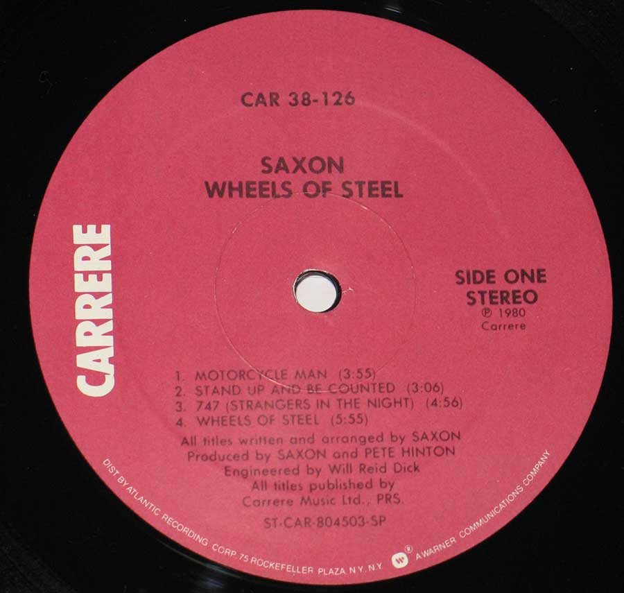 Close up of record's label SAXON - Wheels Of Steel ( USA Release ) Side One