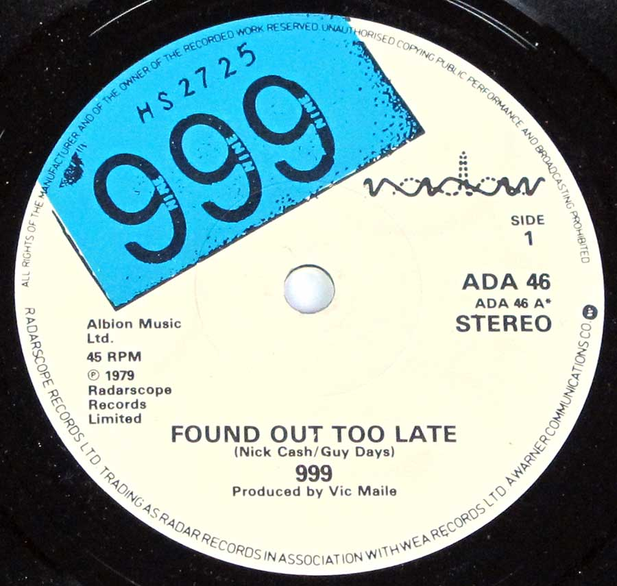 "Close up of Side One record's label 999 - Found Out Too Late,  Lie Lie Lie 7"" 45rpm ps single vinyl"