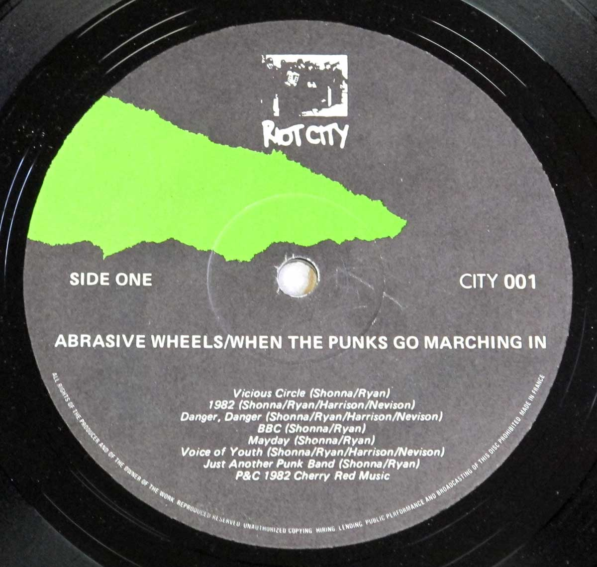 Enlarged High Resolution Photo of the Record's label ABRASIVE WHEELS - When The Punks Go Marching In https://vinyl-records.nl