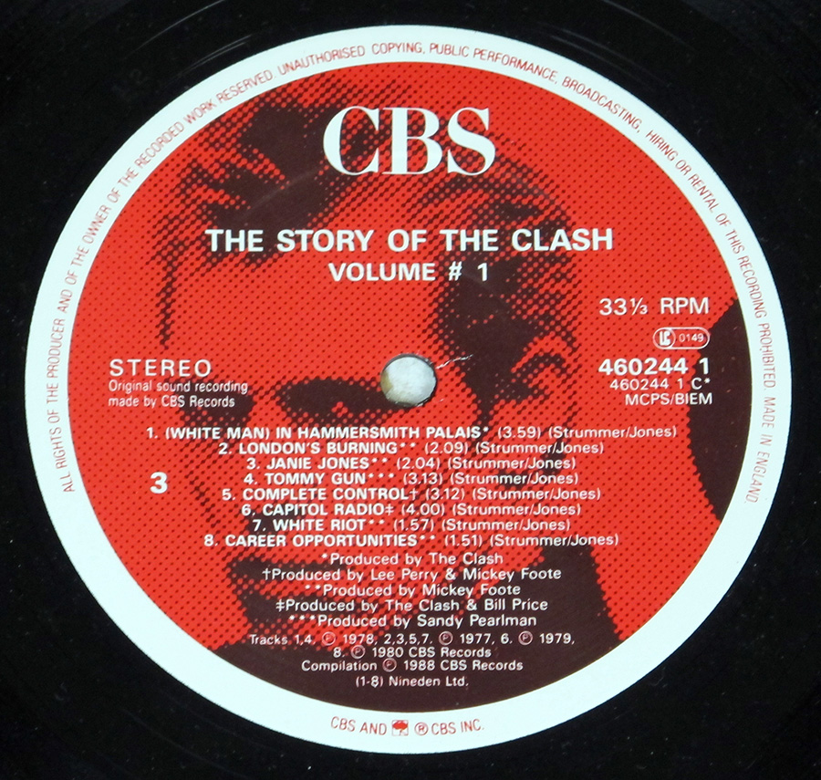 "Close up of record's label THE CLASH - Story Of The Clash Volume 1 12"" Vinyl LP Album Side One"