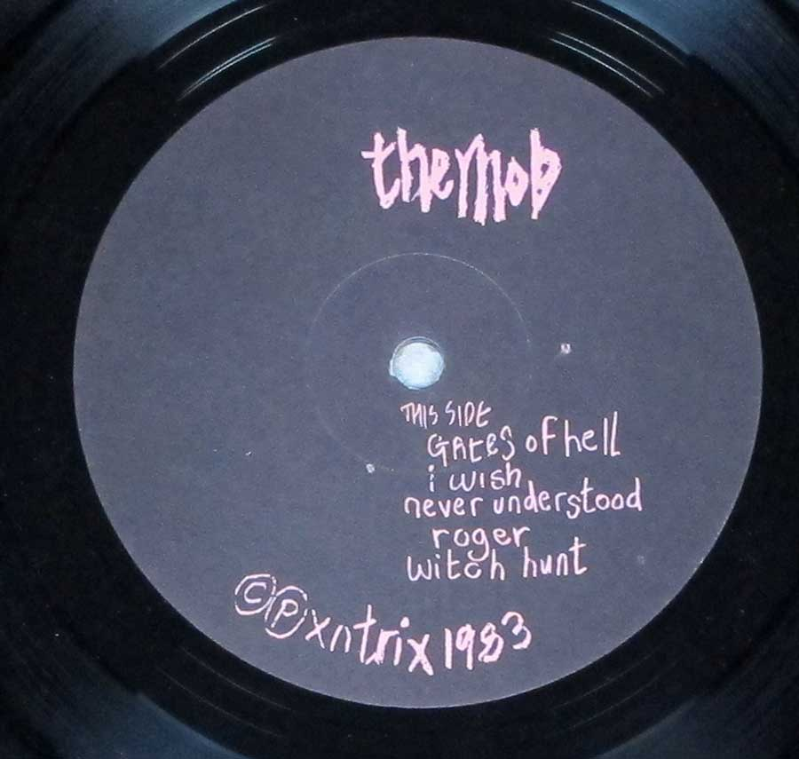 Close up of record's label MOB - Let the Tribe Increase Side One