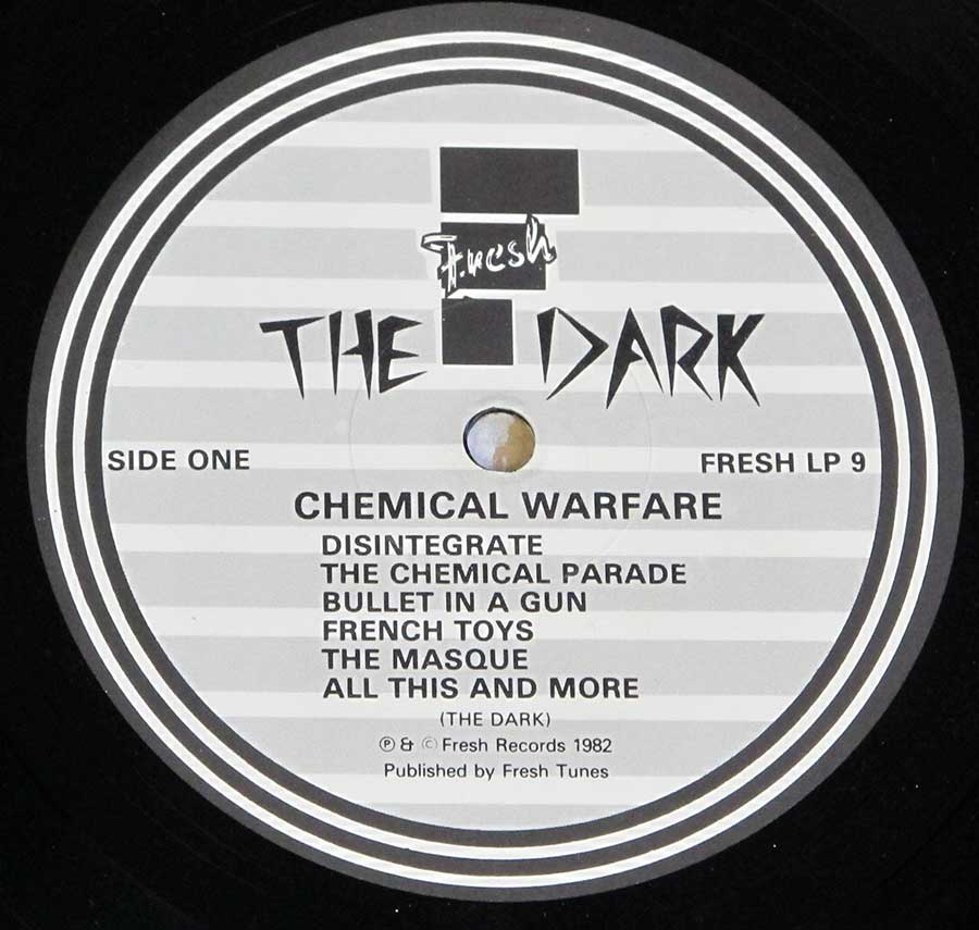 "Close up of record's label THE DARK - Chemical Warfare + LYRICS SHEET FRESH 12"" LP VINYL ALBUM Side One"