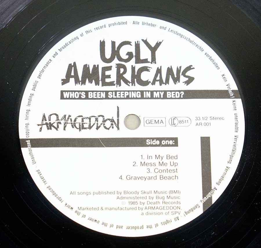 Close up of record's label UGLY AMERICANS - Who's Been Sleeping Side One