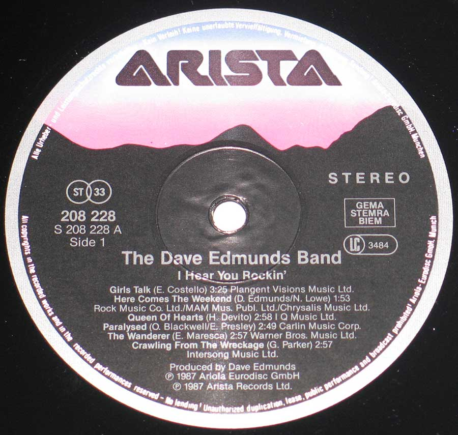 "Close up of record's label Dave Edmunds Band - I Hear You Rockin 12"" Vinyl Album Side One"