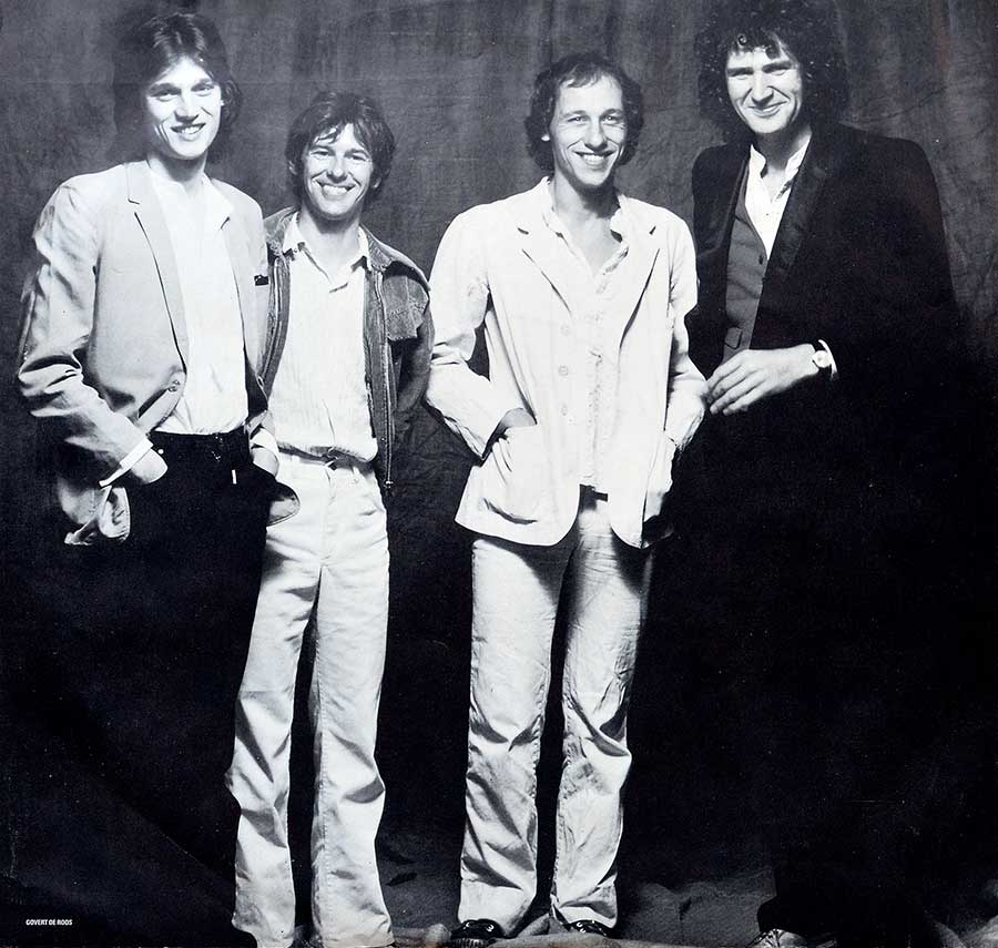 Large full-page group photo of the Dire Straits band
