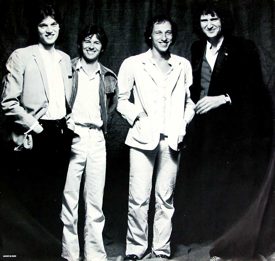 "A full-page black and white group photo of the ""Dire Straits"" band"