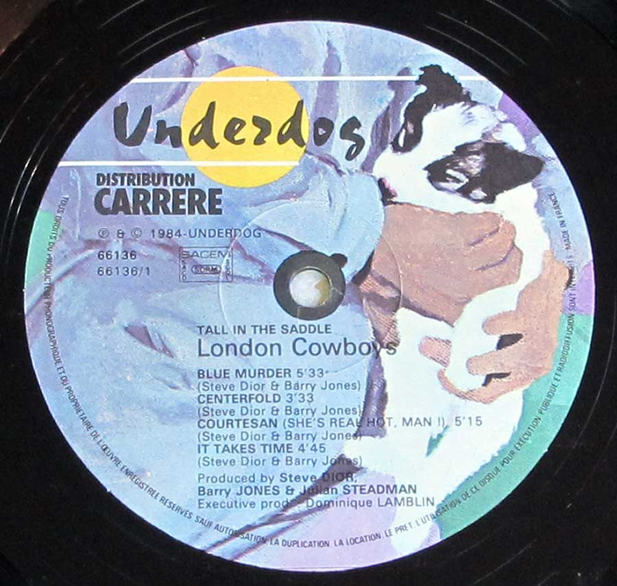 """Tall In The Saddle by the London Cowboys"" Record Label Details: Carrere Underdog 66136 © ℗ 1985 Underdog Sound Copyright"
