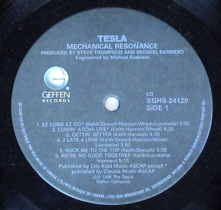 Close up of record's label TESLA - Mechanical Resonance Side One