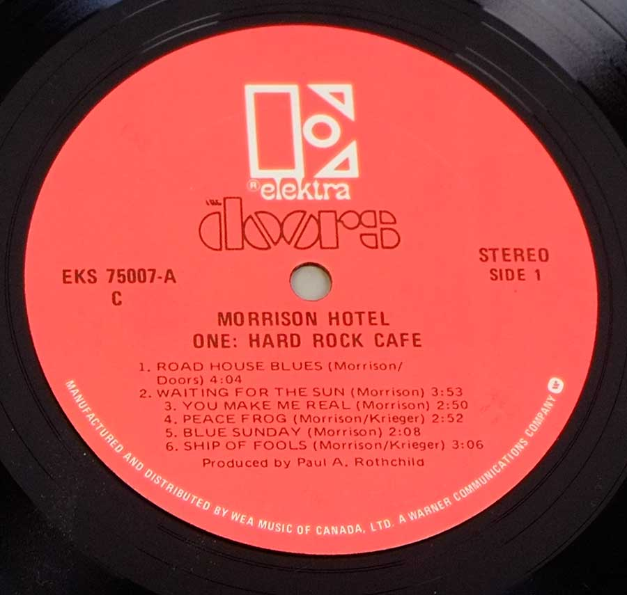 "Close up of record's label DOORS MORRISON - Hotel Red Label Canada 12"" LP Vinyl Side One"
