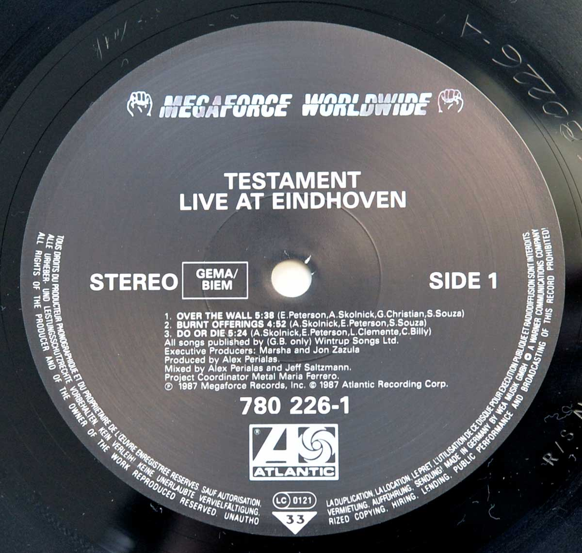 "Enlarged & Zoomed photo of ""TESTAMENT Live at Eindhoven"" Record's Label"